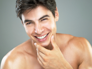 a man smiling with dermal fillers