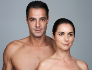 a mature man and woman smiling after wrinkle reduction injections